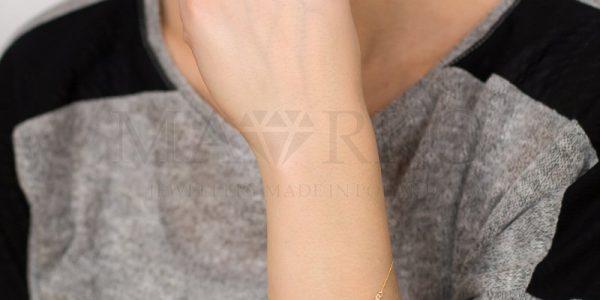 złota damska bransoletka - wzór skrzydła anioła